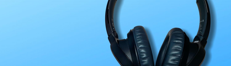 black corded headphones on blue background
